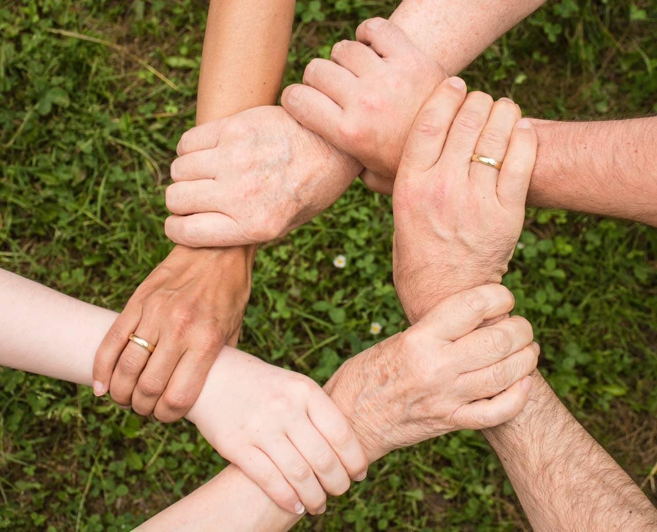 A group of people linking hands